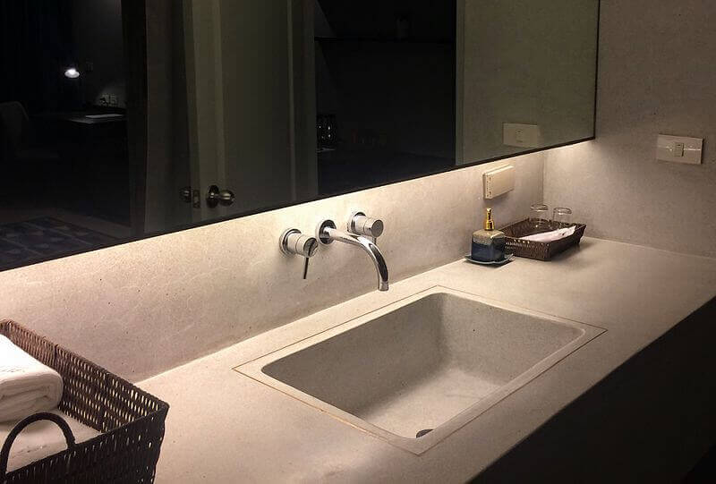 A tap in a bathroom—stainless steel in the application in contact with water